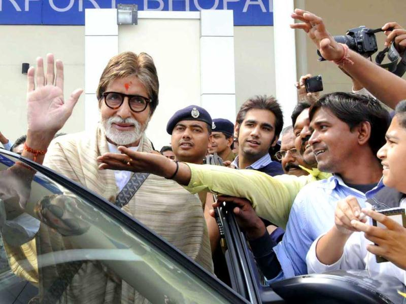 Amitabh Bachchan waves to fans as he shoots in Bhopal. The crowds went delirious as they tried to reach out to the star.