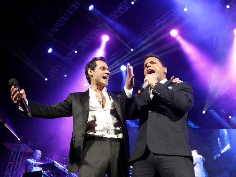 Singer Marc Anthony, left, performs guest artist Tito