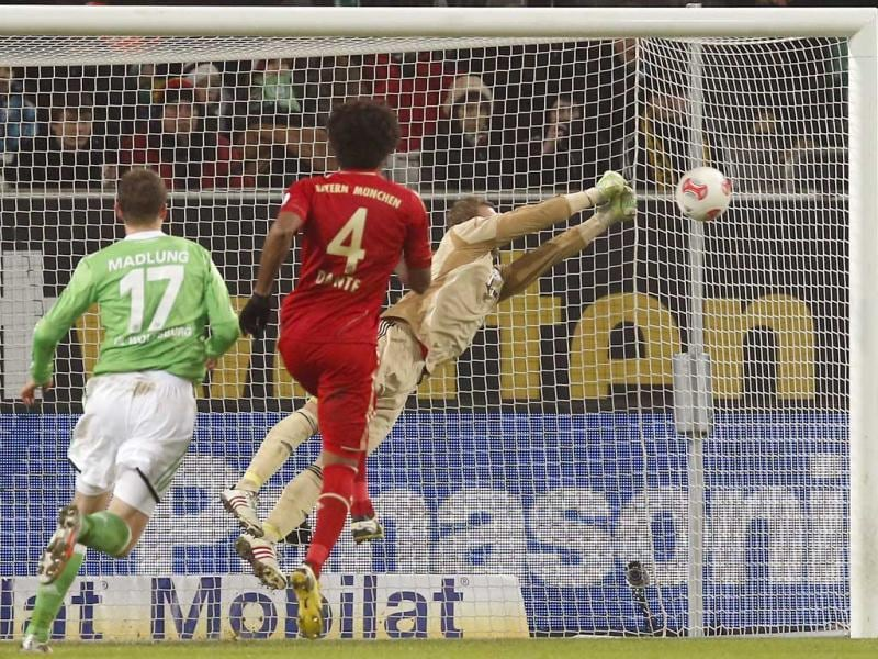 Bayern goalkeeper Manuel Neuer saves a free kick during the German first division Bundesliga soccer match between VfL Wolfsburg and FC Bayern Munich in Wolfsburg, Germany. (AP Photo)