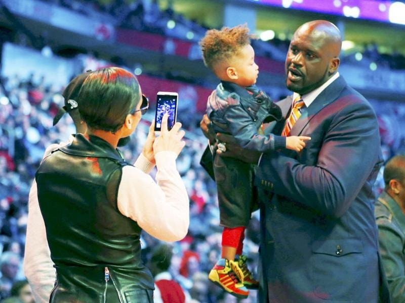 Singer Alicia Keys takes a picture of her son Egypt Daoud Dean with NBA legend Shaquille O'Neal during the NBA basketball All-Star weekend in Houston, Texas. Reuters/Jeff Haynes