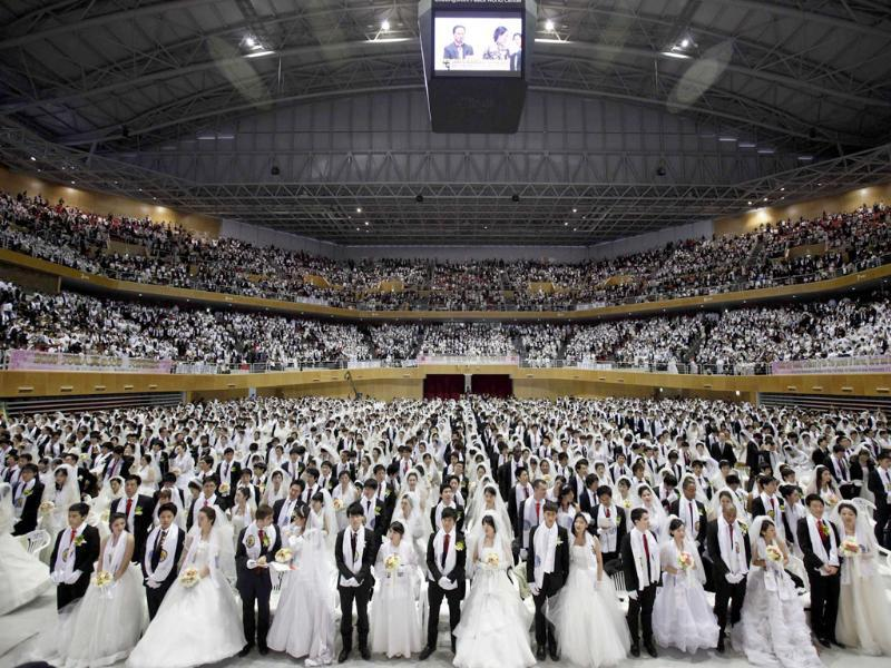 Thousands of newlyweds attend a mass wedding ceremony of the Unification Church at Cheongshim Peace World Centre in Gapyeong, about 60kms northeast of Seoul. Reuters/Kim Hong-Ji