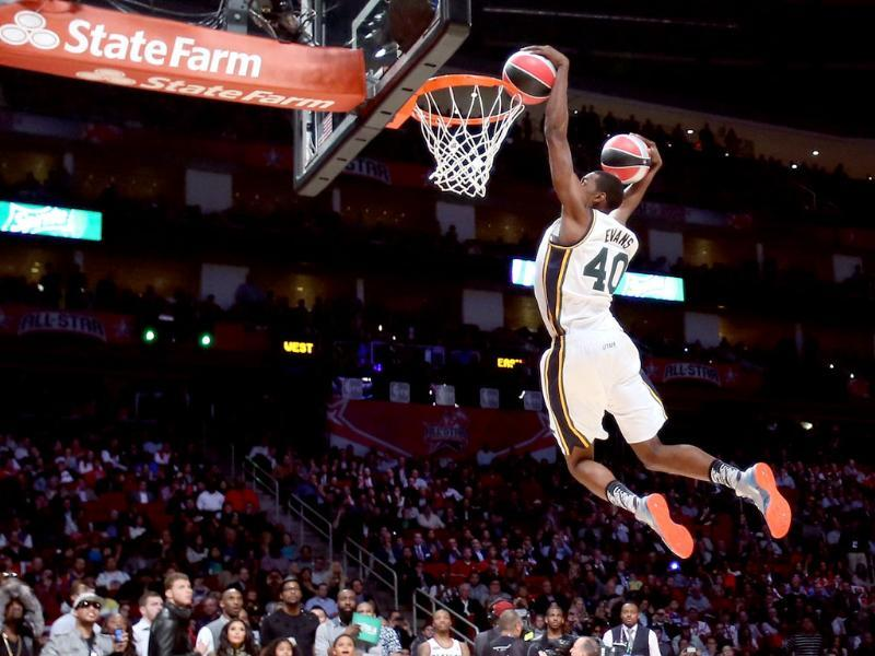 Jeremy Evans of the Utah Jazz dunks two basketballs in the second round during the Sprite Slam Dunk Contest part of 2013 NBA All-Star Weekend at the Toyota Center in Houston, Texas. AFP/Ronald Martinez/Getty Images