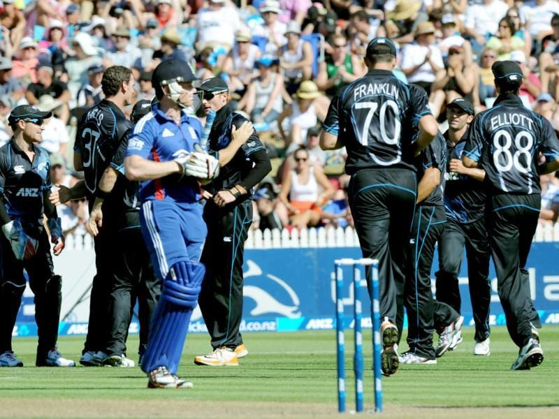 England's Eion Morgan walks as New Zealand celebrate his dismissal for 1 during their first one day international cricket match at Seddon Park, in Hamilton, New Zealand. AP/SNPA, Ross Setford