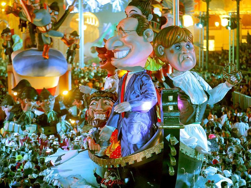 A float depicting French President Francois Hollande and German chancellor Angela Merkel parades during the 129th edition of the Nice Carnival in Nice, southern France. The carnival celebrates the theme