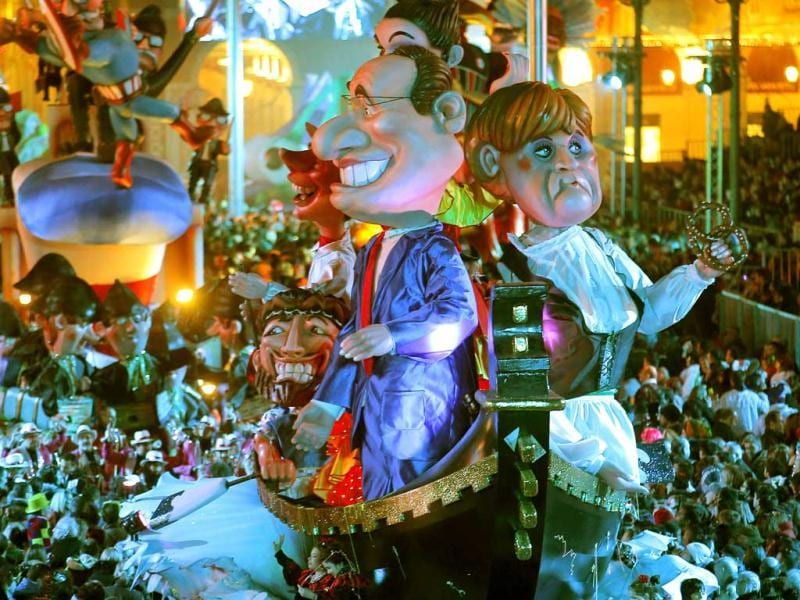 A float depicting French President Francois Hollande and German Chancellor Angela Merkel parades during the 129th edition of the Nice Carnival, France. (AP)