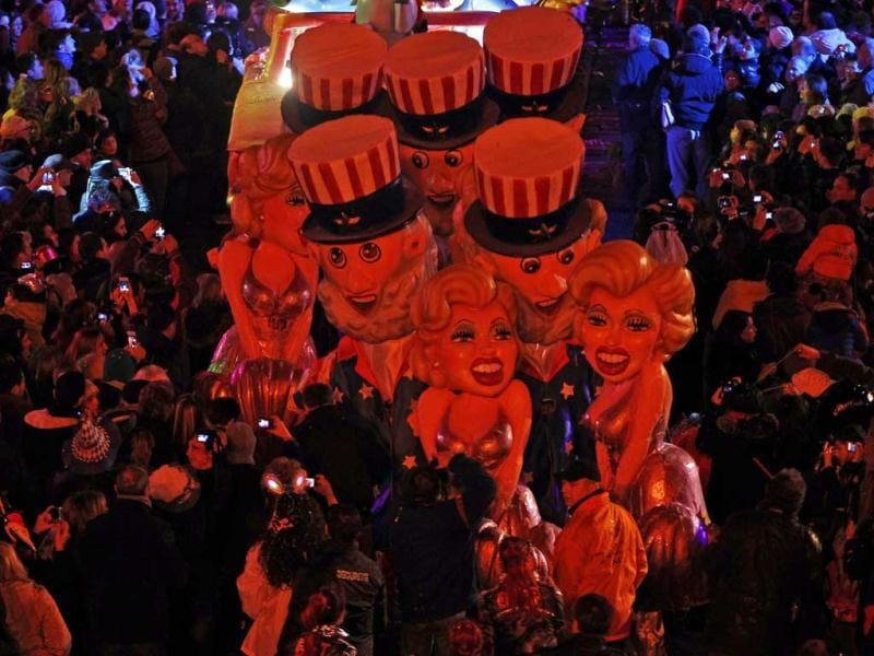 Giant figures of Marilyn Monroe are paraded through the crowd during the Carnival parade in Nice, France. (Reuters)
