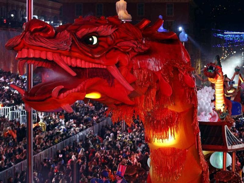 The float with a giant dragon is paraded through the crowd during the Carnival parade in Nice, France. (Reuters)
