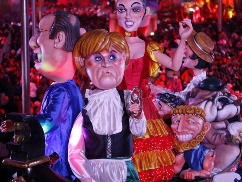 A float featuring French President Francois Hollande and German chancellor Angela Merkel parades during carnival in Nice, France. (AFP)