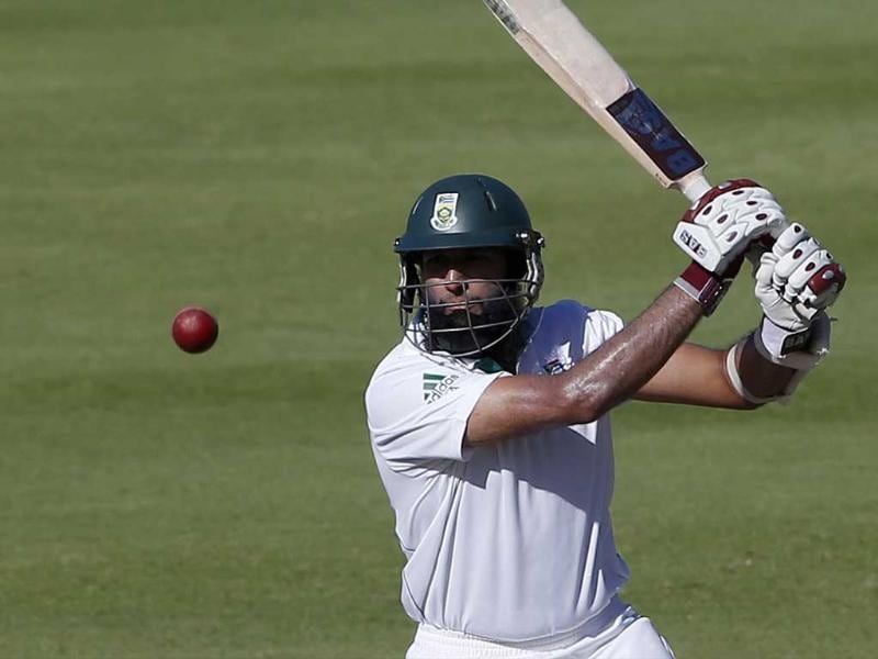 South Africa's Hashim Amla plays a shot on the fourth day of the second cricket test match against Pakistan in Cape Town. REUTERS