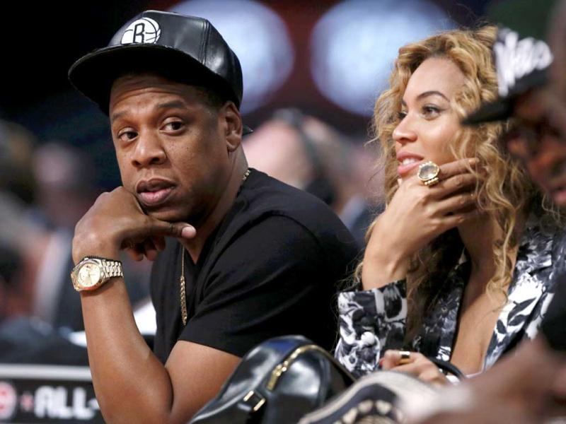 Singer Beyonce and her husband Jay-Z sit courtside at the NBA All-Star basketball game in Houston, Texas. (Reuters)