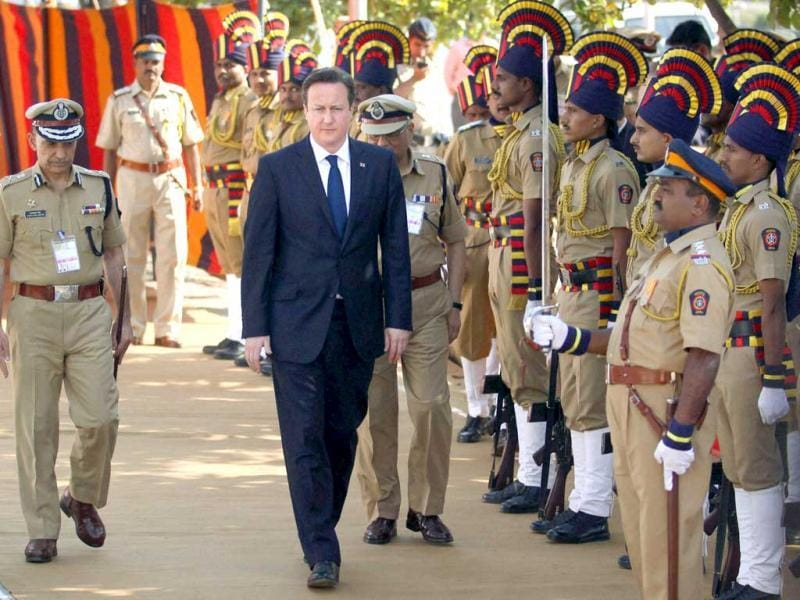 British Prime Minister David Cameron during his visit to the martyr's memorial of 26/11 terror attack in Mumbai. PTI