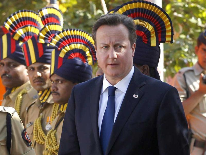 British Prime Minister David Cameron arrives to pay tribute at the Police Memorial in Mumbai. AP