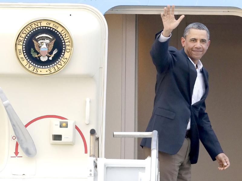 President Barack Obama waves in the doorway of Air Force One as he departs from Palm Beach International Airport in West Palm Beach, Fla. Obama spent the long Presidents Day weekend playing golf. AP/Wilfredo Lee