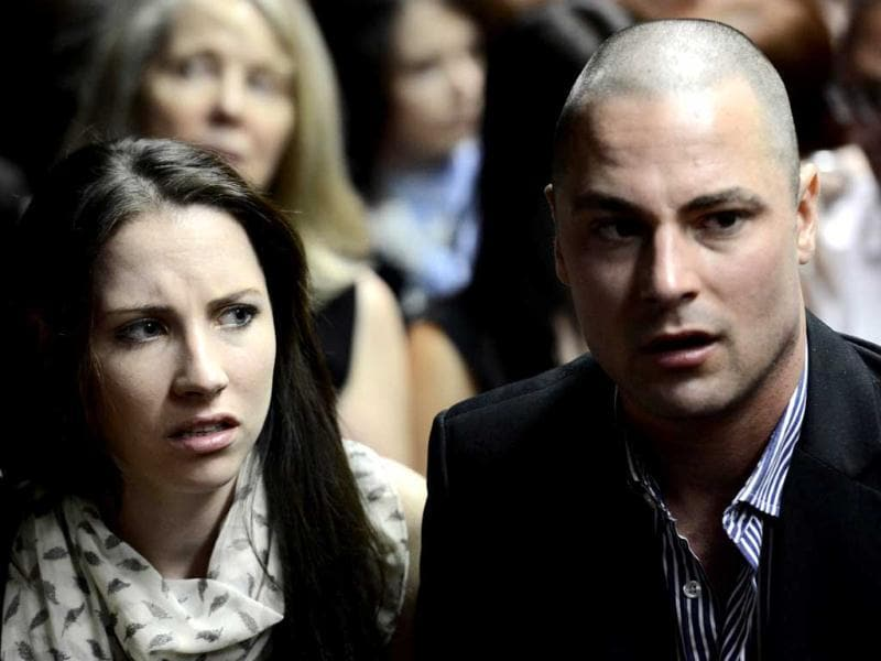 The brother and sister of South African Olympic sprinter Oscar Pistorius, Carl (R) and Aimee (L), in the court room. AFP photo