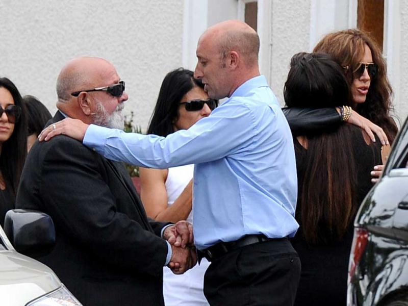 Father of the late South African model Reeva, Steenkamp Barry Steenkamp (2L) arrives at the crematorium building in Port Elizabeth. AFP