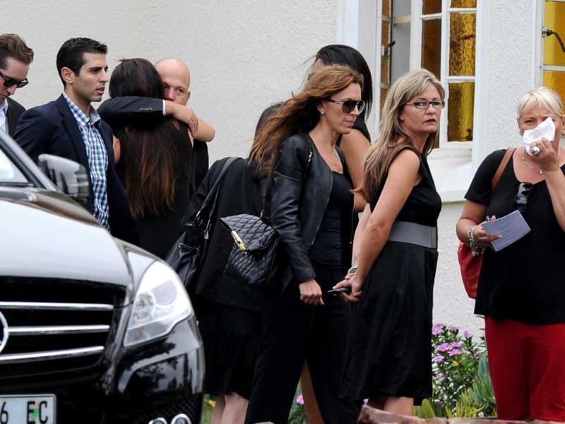 Relatives of the late South African model Reeva Steenkamp arrive at the crematorium building to attend her funeral ceremony in Port Elizabeth . AFP