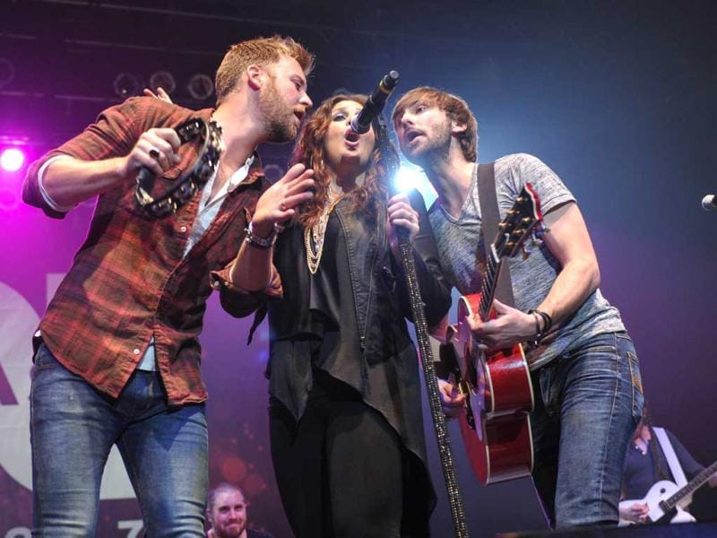 Lady Antebellum, from left, Charles Kelley, Hillary Scott and Dave Haywood perform at NASH FM 94.7's