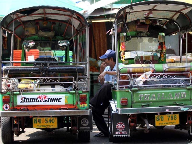 Thai tuk tuk drivers wait for customers in Bangkok, Thailand. (AP)