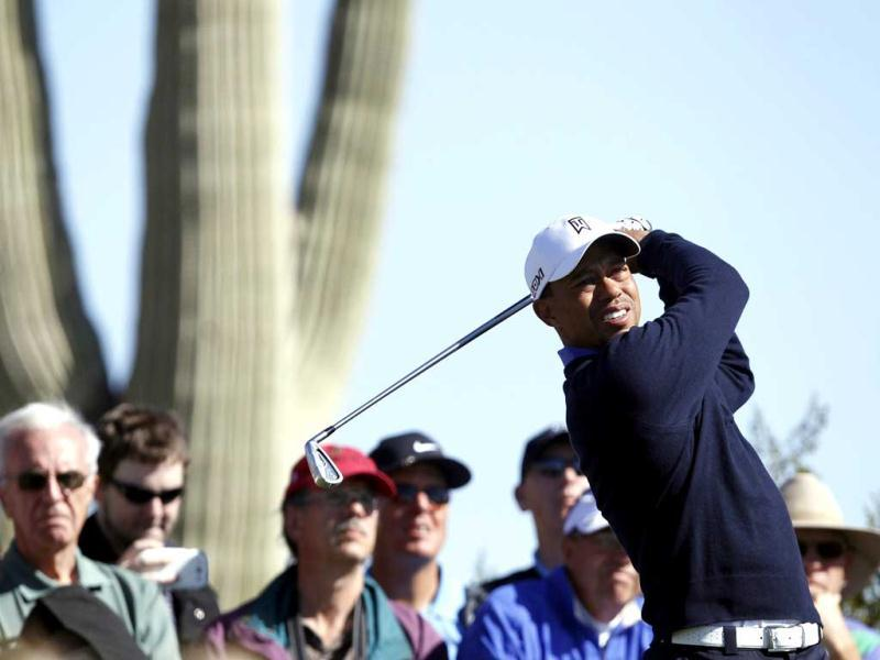 Tiger Woods of the US watches his tee shot on the second hole during a practice round for the WGC-Accenture Match Play Championship golf tournament in Marana, Arizona. (Reuters)