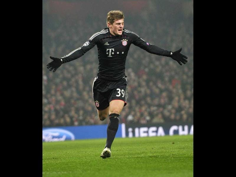 Bayern Munich's German midfielder Toni Kroos celebrates scoring the opening goal during the UEFA Champions League round of 16 football match between Arsenal and Bayern Munich at the Emirates Stadium in north London. (AFP)