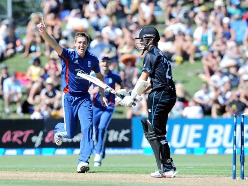 England's Chris Woakes reacts as he bowls New Zealand's Kane Williamson for 33 in the the second one day international cricket match at McLean Park in Napier, New Zealand. (AP)