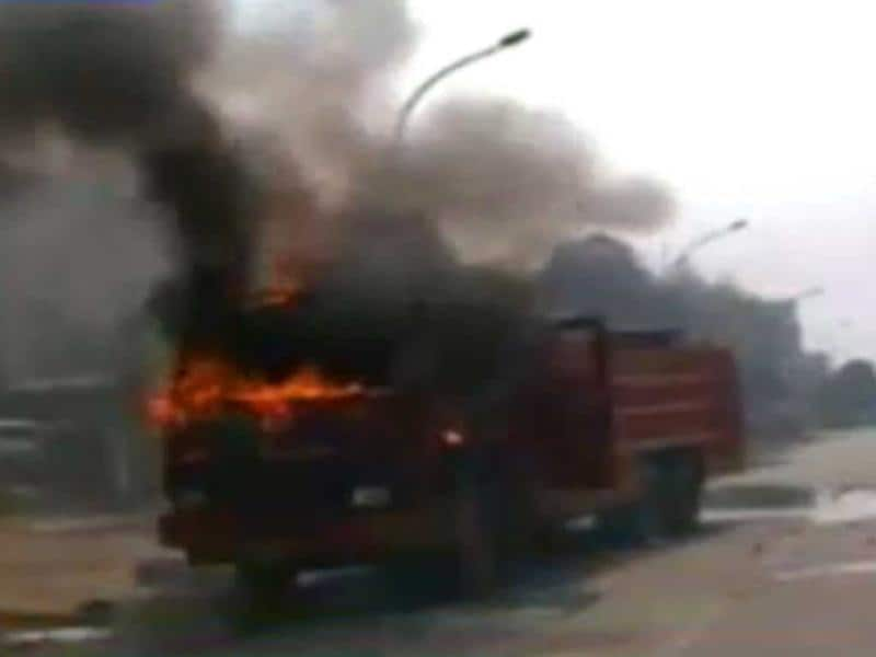 Protesters put a truck on fire during the 2-day trade union strike in Noida. (TV grab)