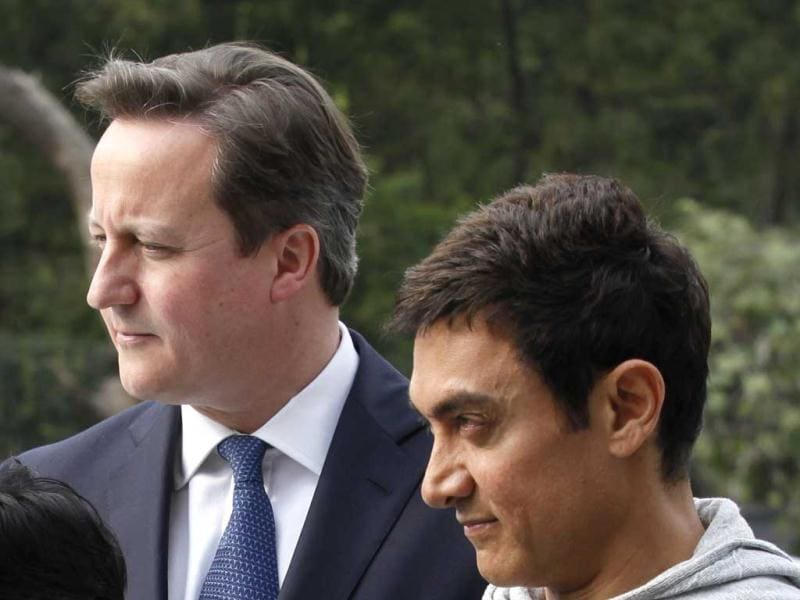 British PM David Cameron and Aamir Khan during an intraction with Women Cab Drivers at Janaki Devi College in New Delhi on Tuesday.(HT Photo)