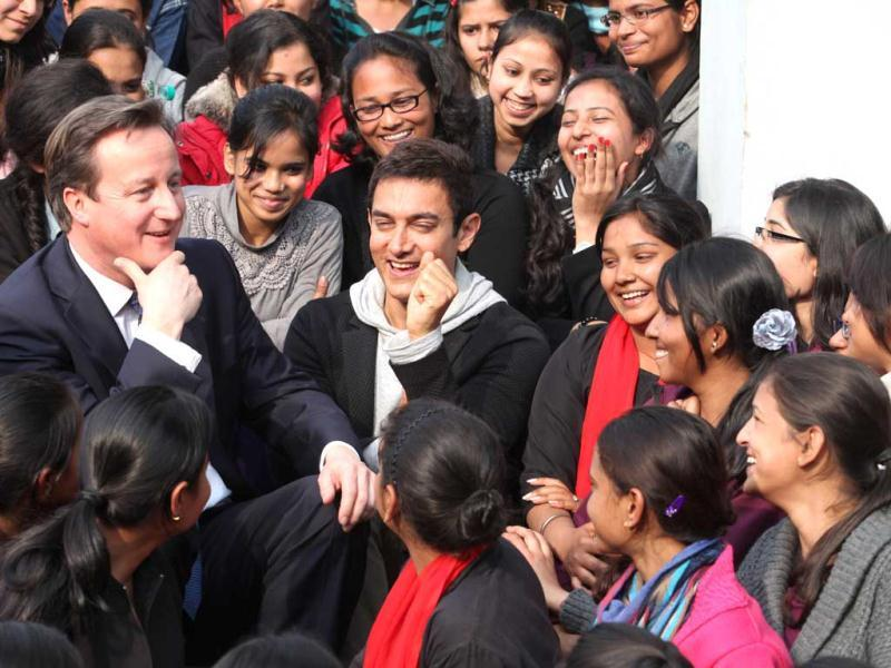 British Prime Minister David Cameron and actor and brand Ambassador of UNICEF to promote child nutrition in India Aamir Khan interact with students at Janki Devi Memorial College, in New Delhi, India, on Tuesday, February 19, 2013. (HT Photo)