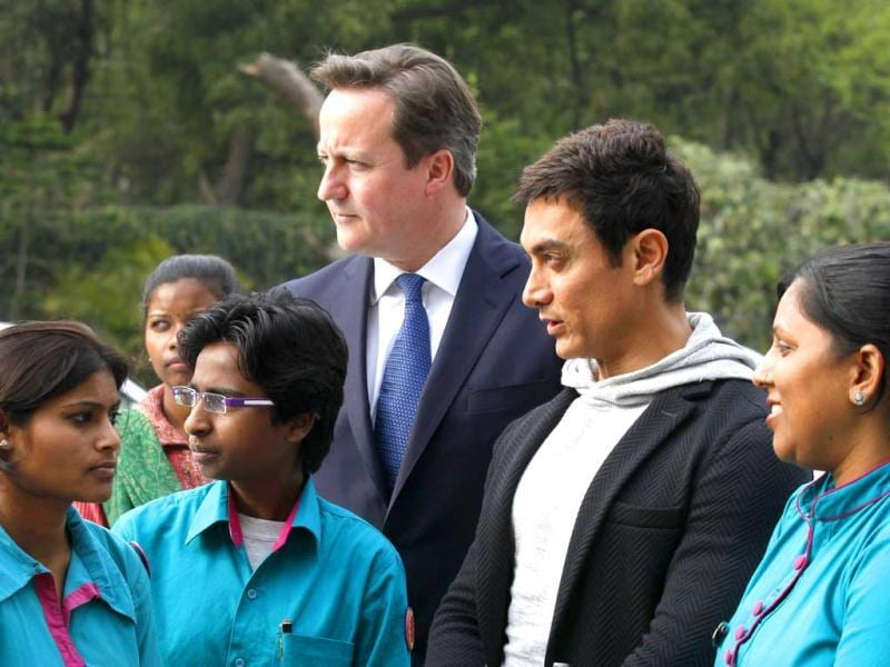 PM David Cameron (center left) and actor UNICEF brand Ambassador to promote child nutrition in India Aamir Khan meet students at Janki Devi Memorial College, in New Delhi on February 19. (HT Photo)