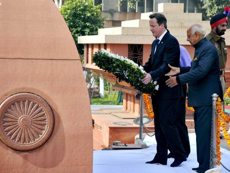 Britain's Prime Minister David Cameron places a wreath at the Jallianwala Bagh memorial in Amritsar. Cameron became the first serving British prime minister to voice regret about one of the bloodiest episodes in colonial India, a massacre of unarmed civilians in the city of Amritsar in 1919. Reuters photo