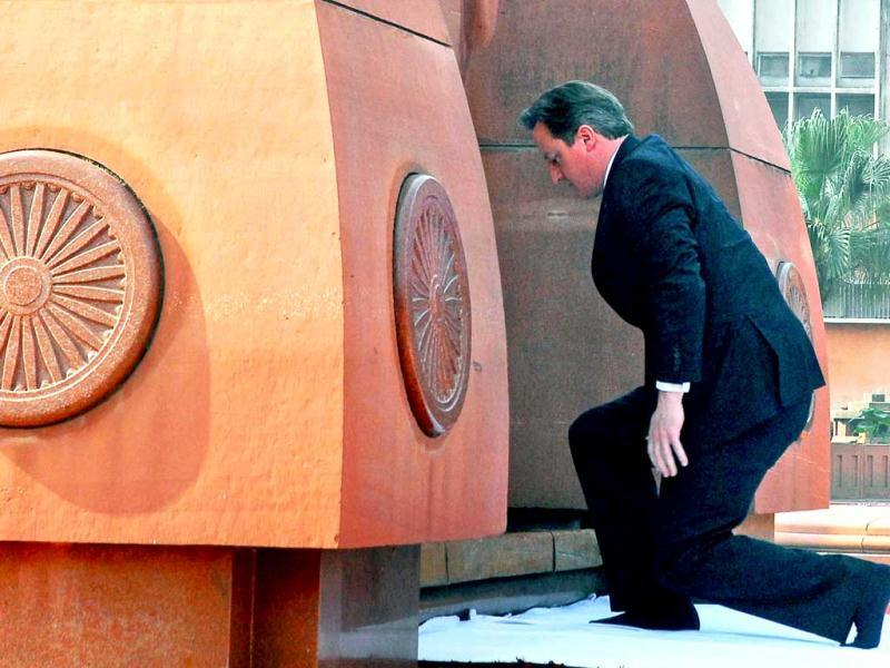 British Prime Minister David Cameron pays his respects at Jallianwala Bagh, the site of a notorious 1919 massacre of hundreds of Indians by British forces, in Amritsar. AP photo