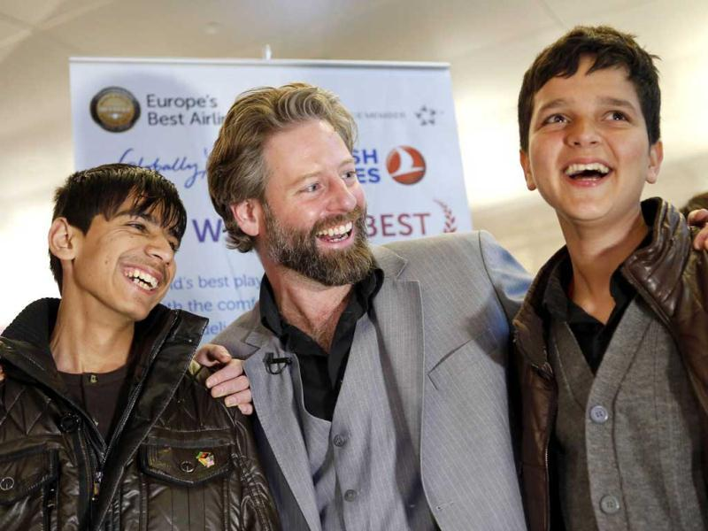 Director Sam French and 14-year-old Afghan actors Fawad Mohammadi and Jawanmard Paiz of the Oscar nominated live-action short film Buzkashi Boys, laugh together after arriving at Los Angeles International Airport (LAX) in Los Angeles, California. The two stars of the movie were able to raise money for their trip from Afghanistan through a social fundraising website, and will attend the Academy Awards on February 24. Reuters/Patrick Fallon