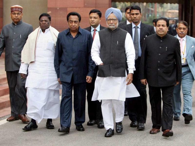Prime Minister Manmohan Singh, flanked by parliamentary affairs minister Kamal Nath and ministers of state V Narayanasamy and Rajiv Shukla, arrives at Parliament House on the first day of the budget session in New Delhi. PTI/Manvender Vashist