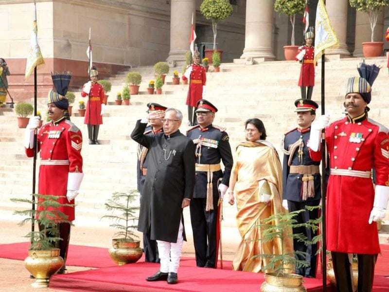 President Pranab Mukherjee takes a salute after inspecting a guard of honour before leaving for Parliament House to address the joint session on the opening day of Budget session at Rashtrapati Bhavan in New Delhi. UNI
