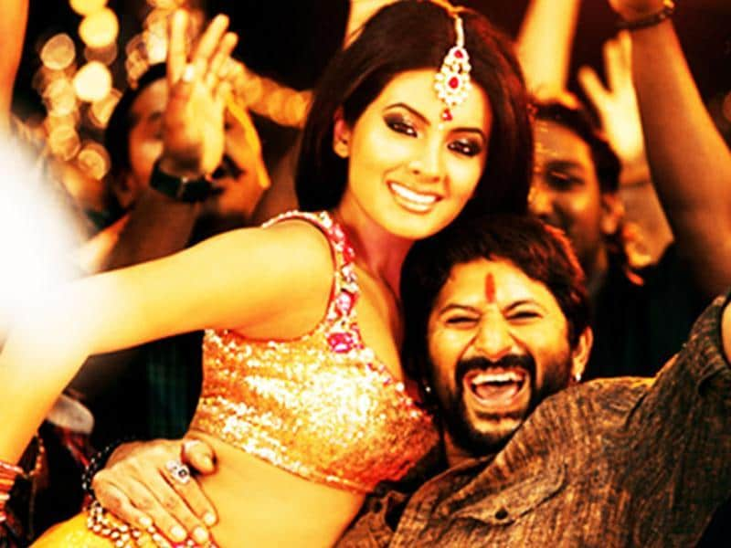 Geeta Basra and Arshad Warsi in a still from the song Ghaziabad Ki Rani in the movie Zila Ghaziabad.