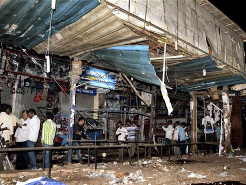 People search for survivors of bomb blast at Dilsukhnagar in Hyderabad. (PTI Photo)