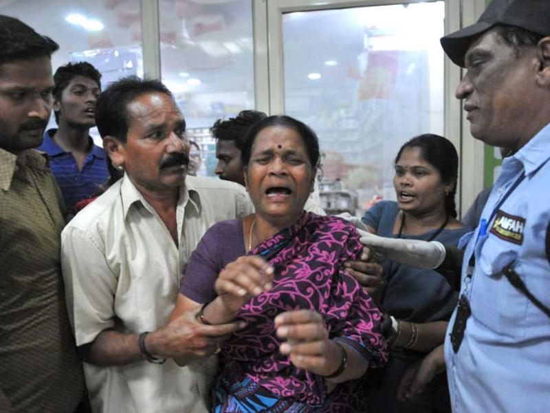 Relative of an injured reacts at the Omini hospital Kothapet following bomb blasts in Hyderabad. (AFP Photo)