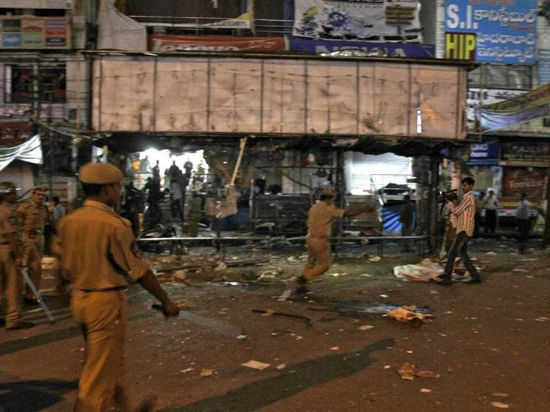 A policeman asks for a TV cameraman to leave the site of an explosion at Dilsukh Nagarm, in Hyderabad. (Reuters)