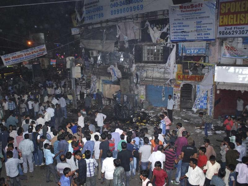 People gather at the bomb blast site in Hyderabad. (AP Photo)