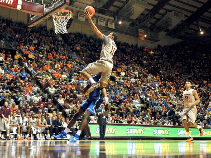 Erick Green #11 of the Virginia Tech Hokies goes to the hoop against the Duke Blue Devils at Cassell Coliseum in Blacksburg, Virginia. Duke defeated Virginia Tech 88-56. (AFP)
