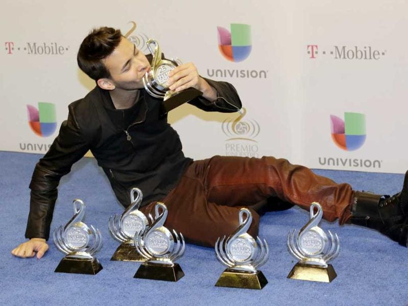 Prince Royce Singer and songwriter Prince Royce kisses one of his six awards the Premio Lo Nuestro Latin Music Awards in Miami. (AP)