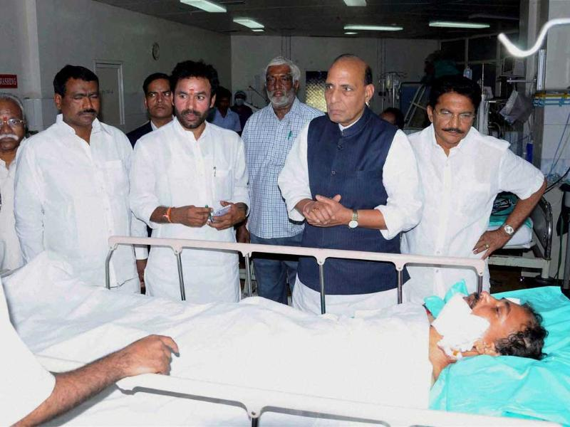 BJP president Rajnath Singh looks at the victim who injured in the blast, at a hospital in Hyderabad. PTI