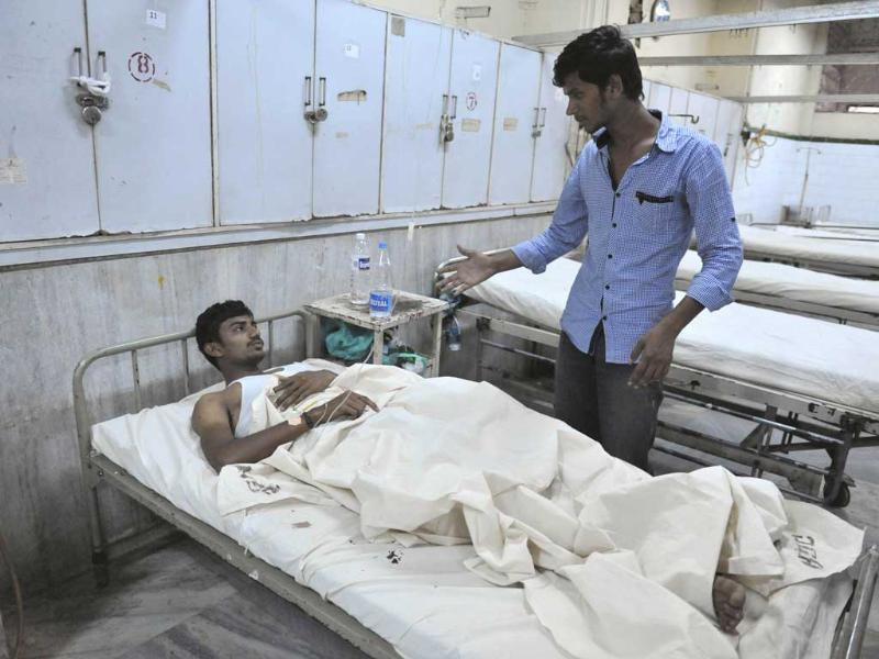 A bomb blast victim is treated at Osmania Hospital in Hyderabad. Twin bombings killed at least 20 people on Thursday outside a popular cinema and bus stand in Hyderabad. AFP/Noah Seelam