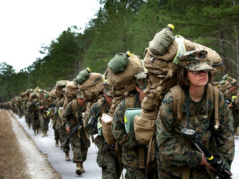 Marines, both male and female, participate in a 10 kilometer training march carrying 55 pound packs during Marine Combat Training (MCT) at Camp Lejeune, North Carolina. AFP photo