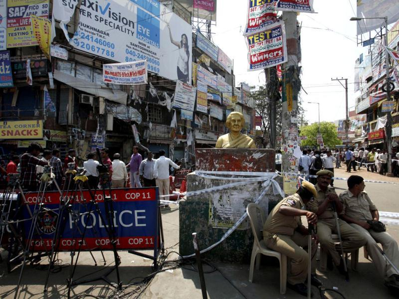 Police guard the site of one of the two bomb blasts in Hyderabad. A man believed to be in his early thirties was seen reaching a traffic signal near the blast site in Dilsukhnagar on a bicycle with a bag hung to its carrier a few minutes before the blasts. AP/Mahesh Kumar A