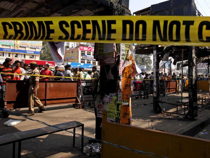 People gather at one of the two bomb blast sites in Hyderabad. As the suspect's face is not clearly visible, the police are taking the help of experts. AP/Mahesh Kumar A