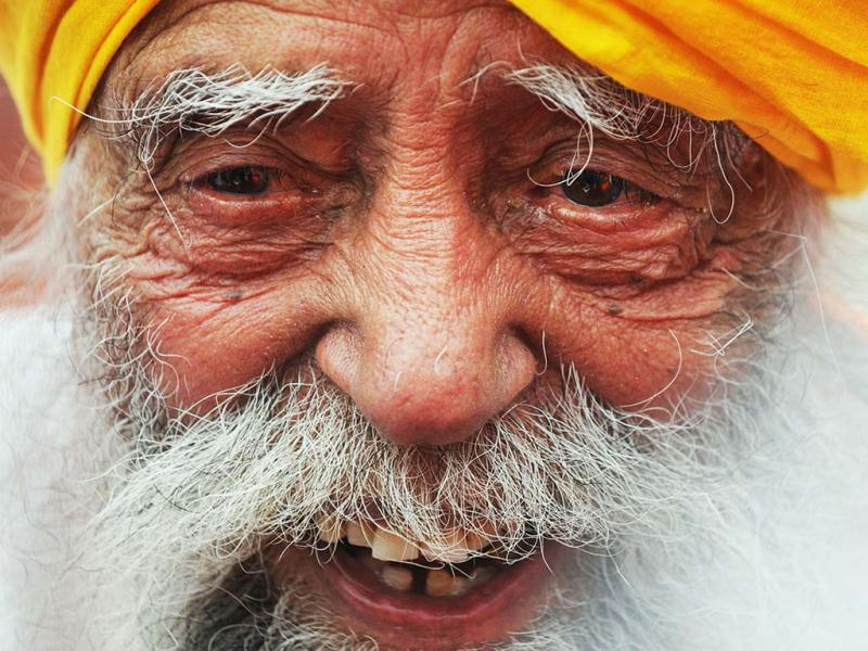 Indian-born British national Fauja Singh, 101 speaks to the media after crossing the finish line in the 10-km event as part of the Hong Kong Marathon. Singh retired from competitive races after the marathon. AFP photo