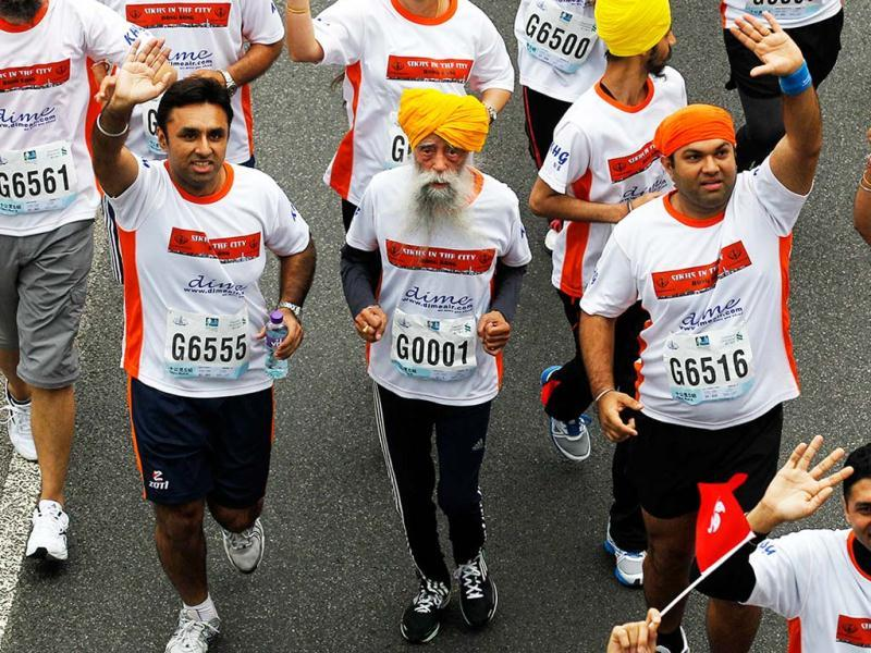 Marathon runner Fauja Singh, 101, center, originally from Beas Pind, in Jalandhar, now living in London, runs in a 10-kilometer race, part of the annual Hong Kong Marathon, in Hong Kong. Singh retired from public racing after competing in the marathon. AP photo