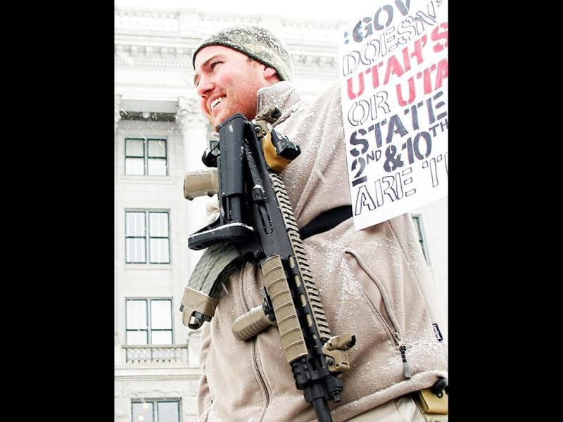 Stokes carries an XCR rifle at a pro-gun activist rally as part of the National Day of Resistance at the state Capitol in Salt Lake CIty, Utah. (Reuters)
