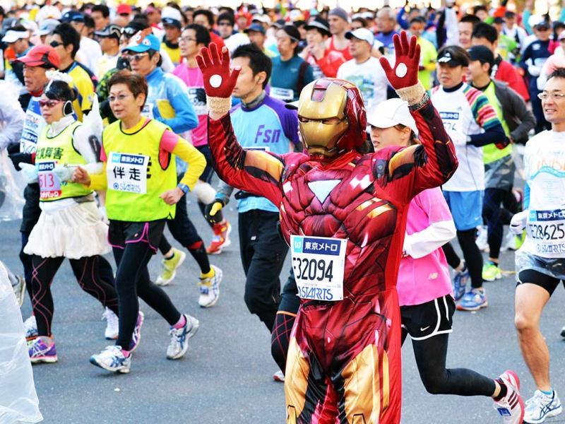 A runner dressed as US comic book hero Ironman takes part in the Tokyo Marathon. (AFP)